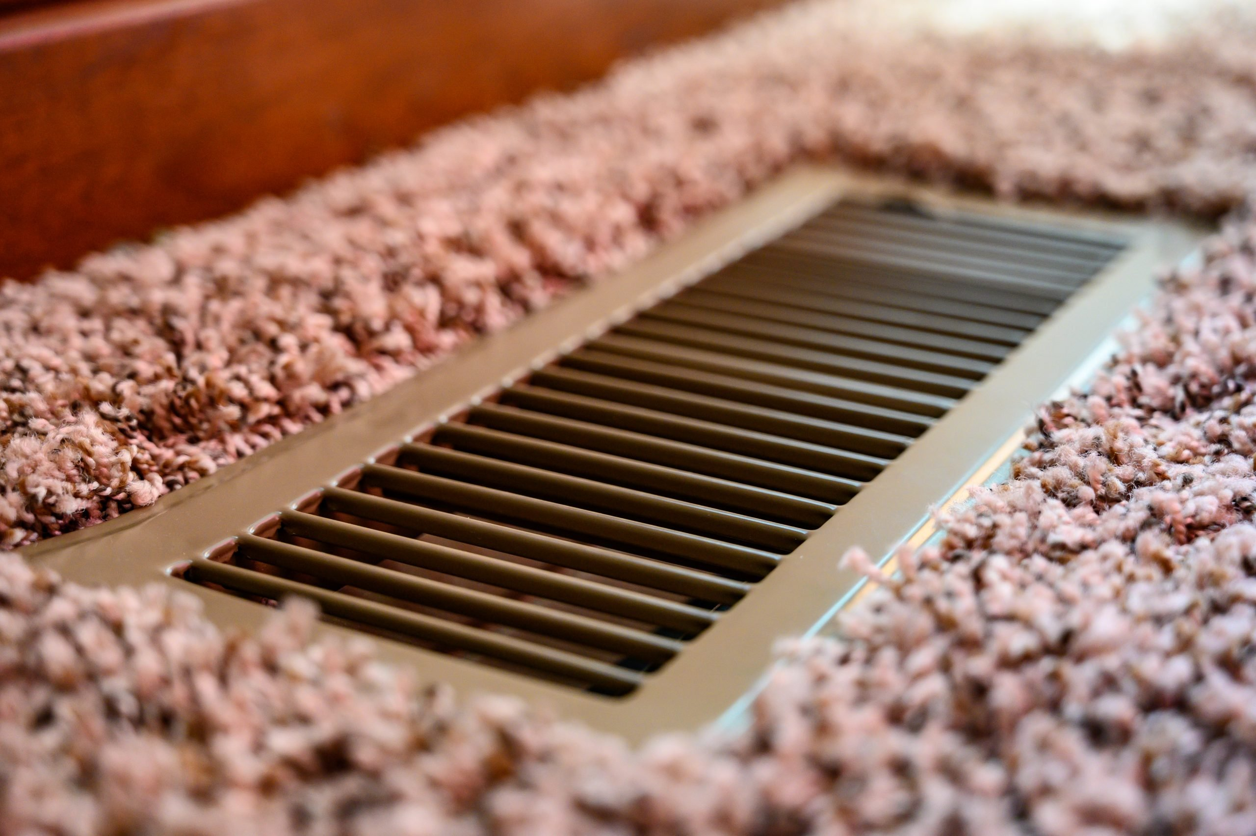 Focus,On,Floor,Vent,In,Room,With,Carpet